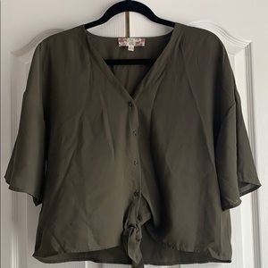 Loose fitting button down and tie bottom blouse